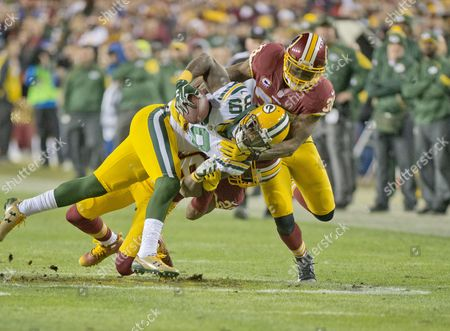 Green Bay Packers wide receiver James Jones (89) is tackled by Washington Redskins free safety Dashon Goldson (38) and Washington cornerback Bashaud Breeland (26) in the second quarter