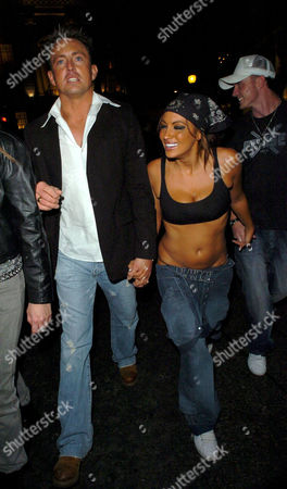Stock Image of Dave Morgan and Jodie Marsh on their way to Chinawhite  after leaving The Embassy Club