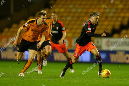 Alex Kacaniklic of Fulham gets away from Kevin McDonald of Wolverhampton Wanderers during the Sky Bet Championship match between Wolverhampton Wanderers and Fulham played at Molineux, Wolverhampton on 12th January 2016