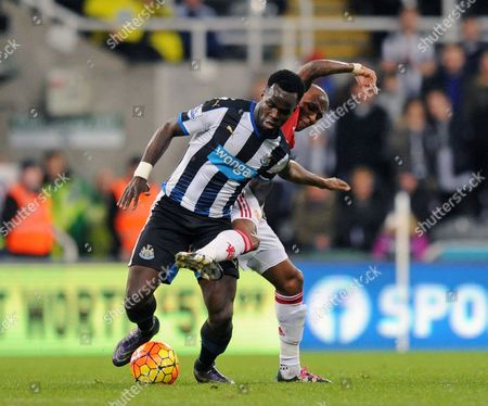 Ashley Young of Manchester United challenges Cheik Tiote of Newcastle United during the Barclays Premier League match between Newcastle United and Manchester United played at St. James' Park, Newcastle upon Tyne, on the 12th January 2016