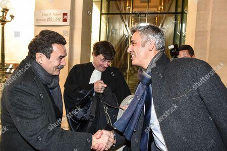 Edwy Plenel and Pascal Bonnefoy shake hands