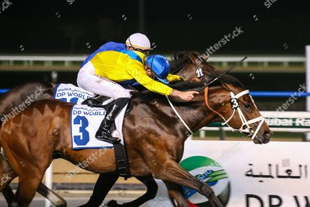 Dubai Meydan World Cup Carnival Forries Waltz (Yellow) and Christophe Soumillon trained by Mike de Kock win race 7