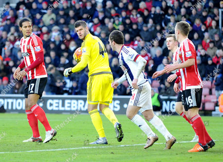 Southamptons Fraser Forster gives West Broms Craig Gardner the eye after a late challenge, during the Barclays Premier League match between Southampton and West Brom at St. Marys on 16th January 2016.