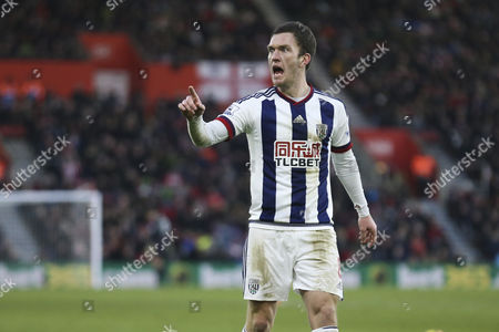 Craig Gardner of West Bromwich Albion doesn't agree with the assistants referees decision of off side