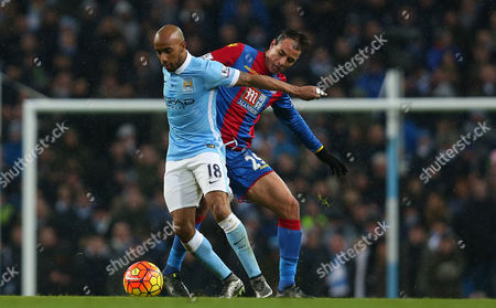Fabian Delph of Manchester City and Marouane Chamakh of Crystal Palace in action during the Barclays Premier League Match between Manchester City and Crystal Palace played at The Etihad Stadium, Manchester on 16th January 2016