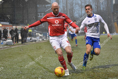 Walsall Defender, James O'Connor sheperds the ball away from Bury Forward, Danny Rose during the Sky Bet League 1 match between Bury and Walsall at Gigg Lane, Bury