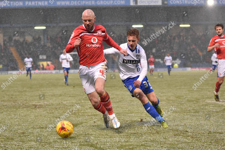 Walsall Defender, James O'Connor and Bury Forward, Danny Rose battle in the snow during the Sky Bet League 1 match between Bury and Walsall at Gigg Lane, Bury