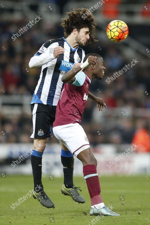 Fabricio Coloccini of Newcastle United out jumps Enner Valencia of West Ham United