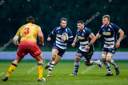 Bristol Rugby Full Back Luke Arscott is challenged by Scarlets XV Prop Will Taylor