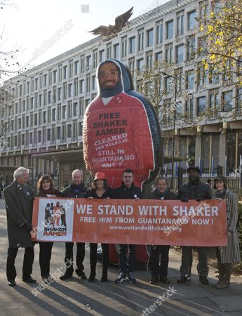 Stock Image of Pictured Outside The American Embassy In Grosvenor Square Central London To Highlight The Plight Of Guantanamo Detainee Shakar Aamer Are (left To Right) Actor William Hoyland (starwars For Your Eyes Only Gandhi) Actress Jan Chappell (blakes Seven) Actor Alan Parnaby Playwright Gillian Slovo (guantanamo) Actor Daniel Cerqueira (ripper Street Call The Midwife) Nicolas Kent (co-director Guantanamo) Actor Patrick Robinson (strictly Come Dancing Casualty) Sacha Wares (co-director 'guantanamo'). See David Wilkes Story.