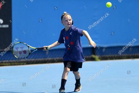 Stock Picture of Cruz Hewitt, son of Lleyton Hewitt of Australia, plays tennis on a practice court during the Australian Open