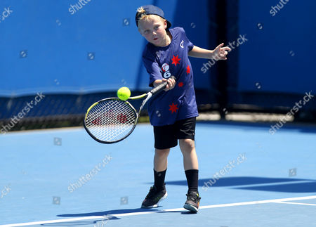 Stock Photo of Cruz Hewitt, son of Lleyton Hewitt of Australia, plays tennis on a practice court during the Australian Open