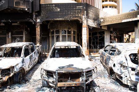Bombed car wrecks in front of Splendid Hotel