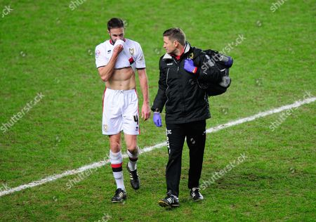Stock Photo of Matthew Upson of MK Dons leaves the game injured during the Emirates FA Cup Third Round Replay match between MK Dons and Northampton Town played at Stadium MK, Milton Keynes on the 19th of January 2016