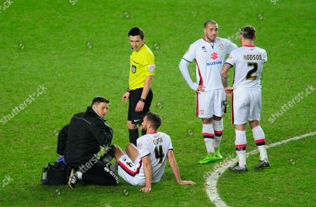 Stock Image of Matthew Upson of MK Dons receives medical treatment during the Emirates FA Cup Third Round Replay match between MK Dons and Northampton Town played at Stadium MK, Milton Keynes on the 19th of January 2016