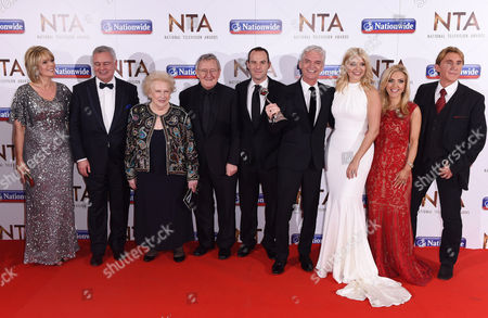 Stock Photo of This Morning stars - Ruth Langsford, Eamonn Holmes, Denise Robertson, Dr Chris Steele, Martin Lewis, Phillip Schofield, Holly Willoughby, Eva Speakman and Nik Speakman