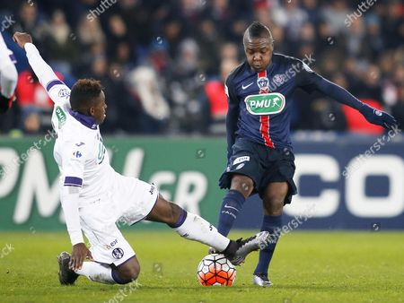 Jacques Francois Moubandje of Toulouse and Hervin Ongenda of PSG
