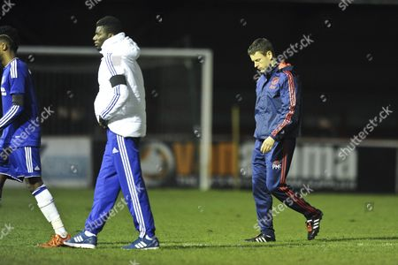 Dejected Manchester United Youth Team manager Paul McGuinness leaves the pitch at the end of the match during Manchester United Youth vs Chelsea Youth at the J. Davidson Stadium