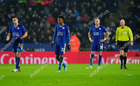 Gokhan Inler, Demarai Gray and Yohan Benalouane of Leicester City look dejected after the Nacer Chadli of Tottenham Hotspur goal during the Emirates FA Cup Third Round Replay match between Leicester City and Tottenham Hotspur played at the Kingpower Stadium, Leicester on the 20th of January 2016