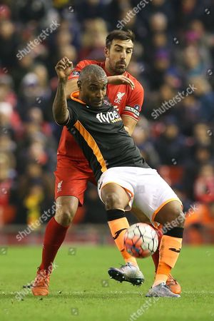 Jose Enrique competes with Clinton Morrison during the FA Cup Third Round Replay match between Liverpool and Exeter City played at Anfield, Liverpool