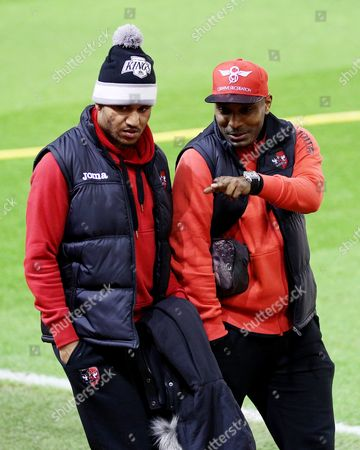 Exeter City's Clinton Morrison (R) arrives at Anfield