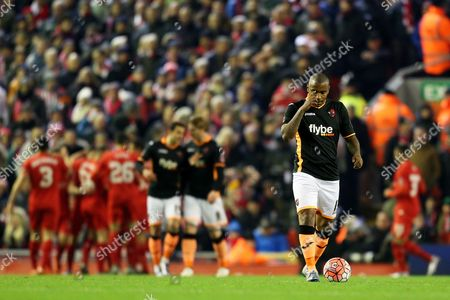 Clinton Morrison of Exeter City looks dejected as Liverpool's Joe Allen celebrates after scoring the opening goal behind