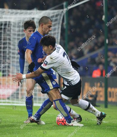 Son Heung-Min of Tottenham Hotspur (R) and Gokhan Inler of Leicester City in action