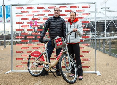 London's Cycling Commissioner Andrew Gilligan and Jessica Ennis with a gold Santander bicycle