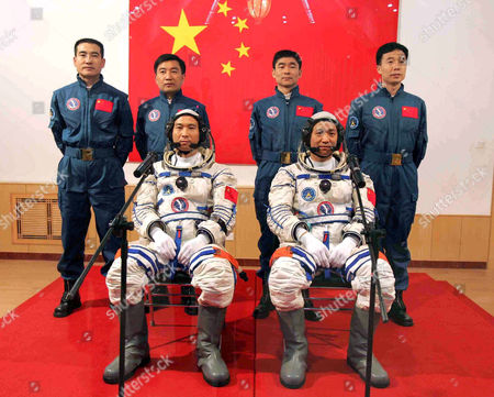 Chinese astronauts Fei Junlong and Nie Haisheng at the front, in spacesuits, behind are Zhai Zhigang, Wu Jie, Liu Boming and Jing Haipeng (from left to right) at the astronauts apartment building Wentiange at the Jiuquan Satellite Launch Center in northwest China's Gansu Province - 12 Oct