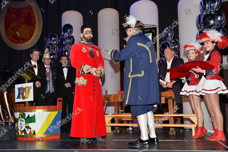 Harald Gloockler is awarded an 'Order of the Fools' medal from Frankenthaler Carnival Club