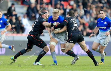 Stock Picture of Jackson Wray of Saracens is tackled by Imanol Harinordoquy (left) and Florian Fritz (12) of Toulouse.