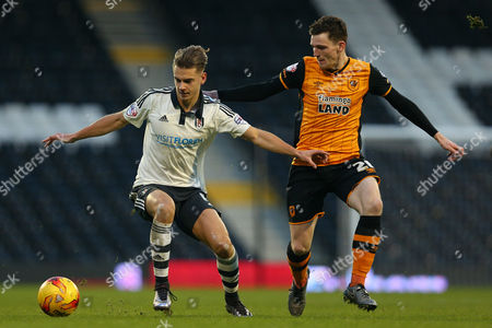 Alex Kacaniklic of Fulham and Andrew Robertson of Hull City in action during the Sky Bet Championship match between Fulham and Hull City played at Craven Cottage, London on 23rd January 2016