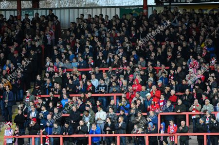 Fans give a miniutes applause in memory of Exeter supporter David Hunt during the Sky Bet League 2 match between Exeter City and Accrington Stanley at St James' Park, Exeter
