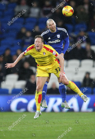 Luciano Becchio of Rotherham and Matthew Connolly of Cardiff City compete for the ball