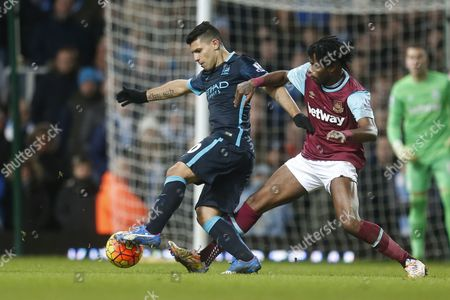 Sergio Aguero of Manchester City and Alexandre Song of West Ham United