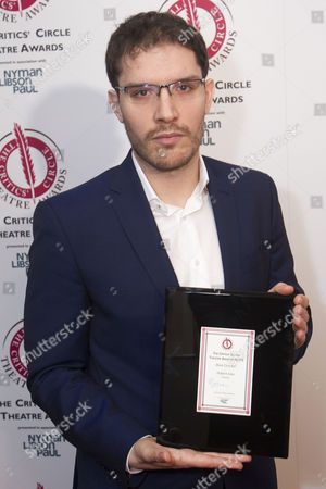 Robert Icke accepts the award for Best Director for Oresteia