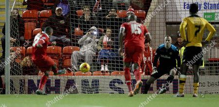 Jay Simpson scores Orient's late winning penalty.