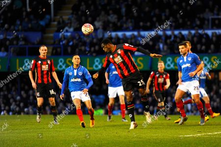 AFC Bournemouth defender Sylvain Distin heads the ball clear of his box during the The FA Cup fourth round match between Portsmouth and Bournemouth at Fratton Park, Portsmouth