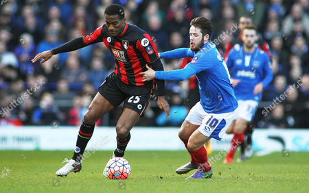 Sylvain Distin of Bournemouth and Marc McNulty of Portsmouth during the Emirates FA Cup 4th round match between Portsmouth and AFC Bournemouth played at Fratton Park, Portsmouth on January 30th 2016