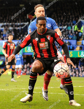 Bournemouths exPortsmouth player Sylvain Distin holds off Portsmouths Ben Davies, during the FA Cup 4th Round between Portsmouth and Bournemouth, at Fratton Park on 30th January 2016.