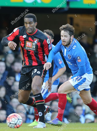 Sylvain Distin (L) of Bournemouth and Marc McNulty (R) of Portsmouth.