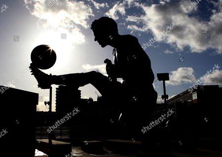 The Dennis Bergkamp statue at The Emirates Stadium