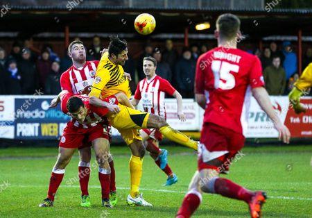 Rory Fallon of Bristol Rovers wins a header