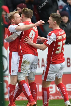 Chris Burke of Rotherham United celebrates with Rotherham United midfielder Danny Ward and Rotherham United midfielder Richard Smallwood  scoring to go1 all  during the Sky Bet Championship match between Rotherham United and Charlton Athletic at the New York Stadium, Rotherham