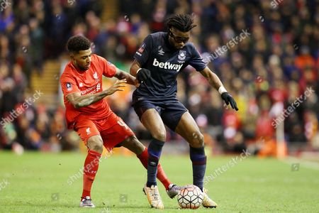 Jerome Sinclair competes with Alex Song during the Emirates FA Cup 4th round match between Liverpool and West Ham played at Anfield, Liverpool on January 23rd 2015