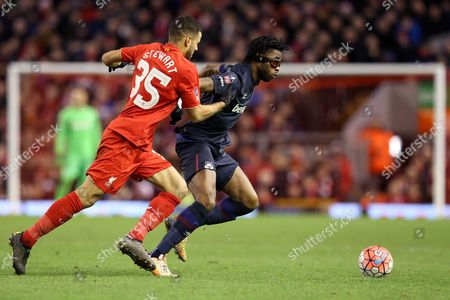 Alex Song  competes with Kevin Stewart during the Emirates FA Cup 4th round match between Liverpool and West Ham played at Anfield, Liverpool on January 23rd 2015