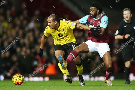 Gabriel Agbonlahor of Aston Villa ad Alex Song of West Ham during the Barclays Premier League match between West Ham United and Aston Villa played at Upton Park, London on February 2nd 2016
