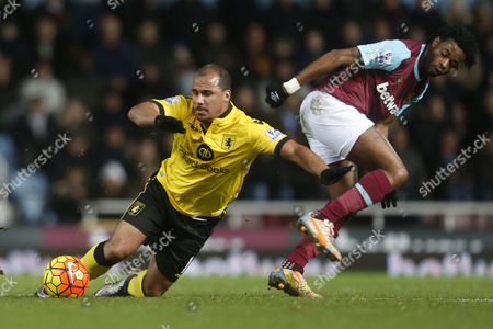 Alexandre Song of West Ham United brings down Gabriel Agbonlahor of Aston Villa