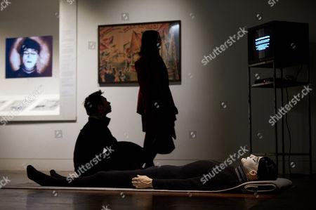 An attendee observes Goshka Macuga, Somnambulist, 2006
