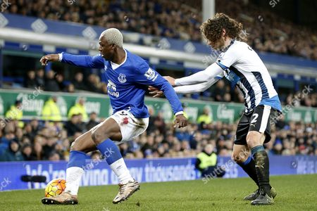 Arouna Kone competes with Fabricio Coloccini during the Barclays Premier League match between Everton and Newcastle United played at Goodison Park on February 3rd 2016